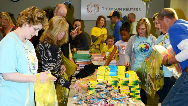 Volunteers assemble birthday gifts for low-income children at the Birthday Bag Blitz on Make a Difference Day in October  in Eagan, Minn.