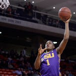 LSU forward Jarell Martin (1) shoots over Auburn forward Cinmeon Bowers (5) during LSU's 84-61 road win Tuesday night. Martin finished with 25 points and 12 rebounds.
