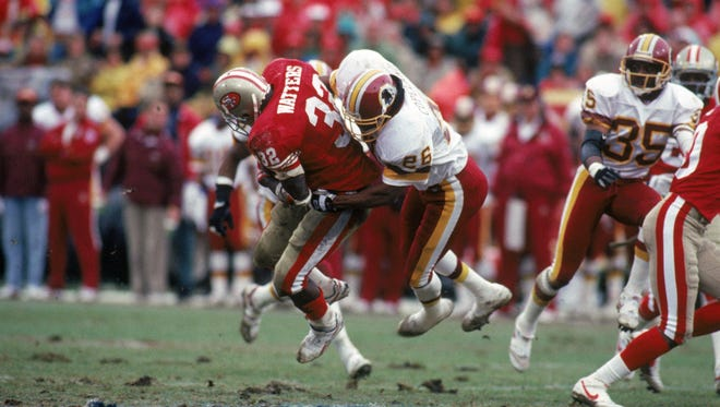 Washington's Danny Copeland (26) tackles San Francisco's Ricky Watters during the 1992 NFC Divisional Playoff game. Copeland will be putting on a skills clinic in Rockledge on July 25.