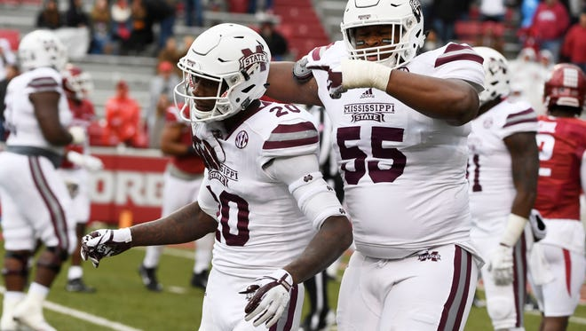 Mississippi State receiver Reggie Todd (20) celebrates with teammate Martinas Rankin after scoring a touchdown against Arkansas.