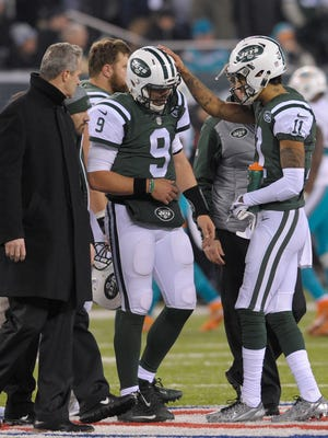 Jets quarterback Bryce Petty (9) walks off the field after an injury during the fourth quarter of a game against the Miami Dolphins, Saturday, Dec. 17, 2016, in East Rutherford, N.J.
