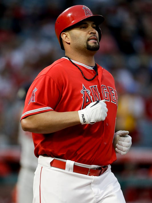 Los Angeles Angels' Albert Pujols reacts after hitting into a double play against the Atlanta Braves during the first inning of a baseball game in Anaheim, Calif., Wednesday, May 31, 2017. (AP Photo/Chris Carlson)