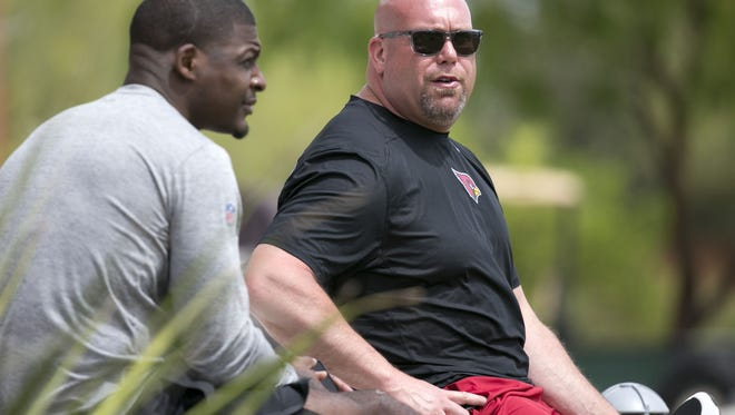 Cardinals scout and former player Adrian Wilson (left) and Cardinals general manager Steve Keim look on during the Cardinals Spring practice at the Cardinals training facility in Tempe on April 19, 2018.