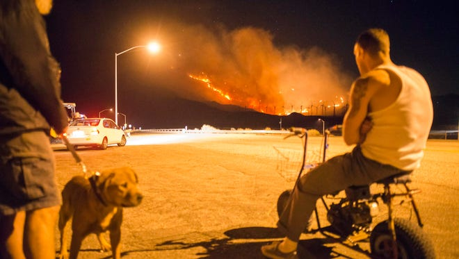 Residents near the town of Whitewater, Calif., watch flames from the Silver Fire on Aug. 8.