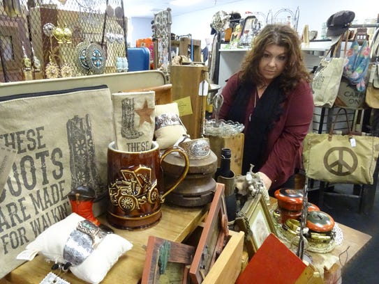Ally Suter looks over a few free trade items she sells