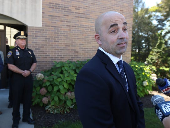 Canandaigua City Police Chief Stephen Hedworth holds