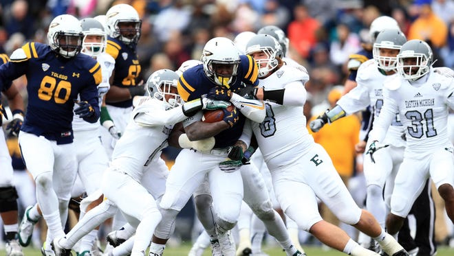 Running back Kareem Hunt #3 of the Toledo Rockets runs the ball during the second quarter against the Eastern Michigan Eagles at Glass Bowl on October 17, 2015 in Toledo, Ohio.