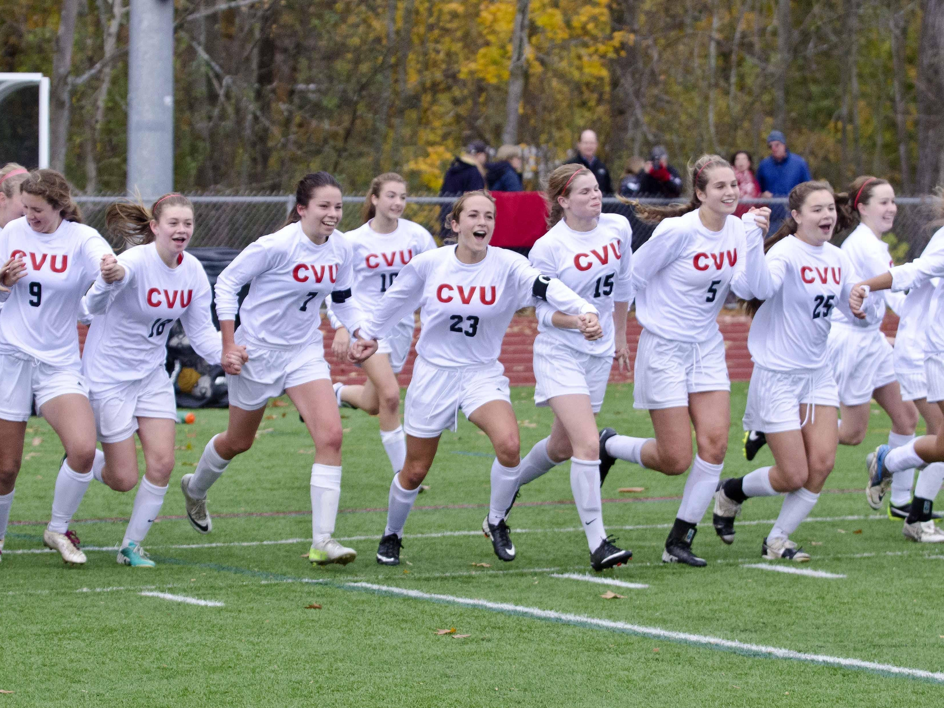 CVU celebrates its victory over Essex in the Division 1 state high school soccer championships in Burlington on Nov. 2, 2013.