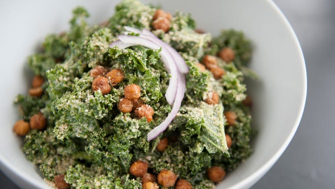 A Caesar Salad from Leaf vegan eatery in Haddonfield includes massaged kale topped with roasted chickpeas, red onions, vegan 'Parmesan,' and a creamy cashew Caesar dressing.