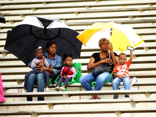 Fans watch the annual Orange and Green Game at Bragg Memorial Stadium.