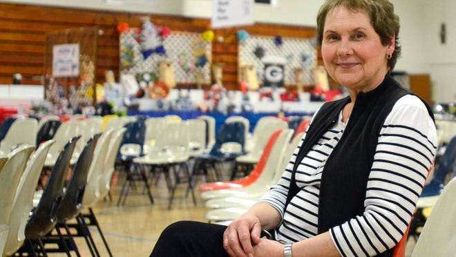 Jan Hoyt, coordinator for Roncalli's Pierside Auction, is leaving her position after 17 years.