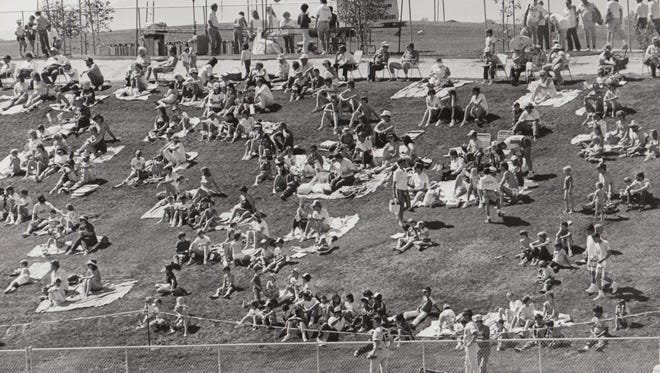 Baseball fans who wish to only pay $2 for a seat can spread their own blanket on the lawn in a special section at the stadium during spring training March 11, 1987. The fans are shown doing just that during the Brewers/Padres game.