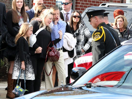 Jennifer Farina with her children at the funeral for