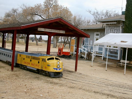 Narrow-gauge railroad carries passengers on a 3-mile-loop through Alameda Park in Alamogordo.