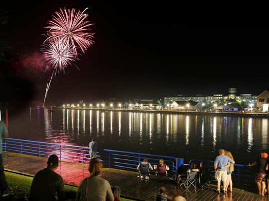 A smaller crowed, due to rainfall, enjoyed the Fourth of July fireworks along the Sheboygan Riverfront, Wednesday, July 4, 2018, in Sheboygan, Wis.