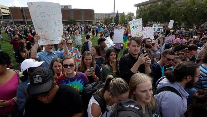 Hundreds of supporters of IUPUI's  LGBTQ+ Center staged a counterprotest on the campus as a handful of members of Westboro Baptist Church in Topeka, Kan., showed up to protest the center Tuesday, Oct. 4, 2016.