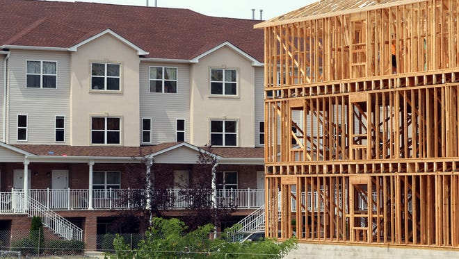Construction continues on new units on the east side of the West Gate development in Lakewood Thursday, August 6, 2015.