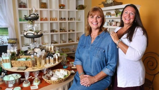 Jeanine Moneypenny, left, and Teri Amsler with Moss Hill inside their St. Matthews shop. July 8, 2014
