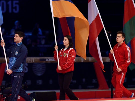 Houry Gebeshian, second from left, carries the Armenian