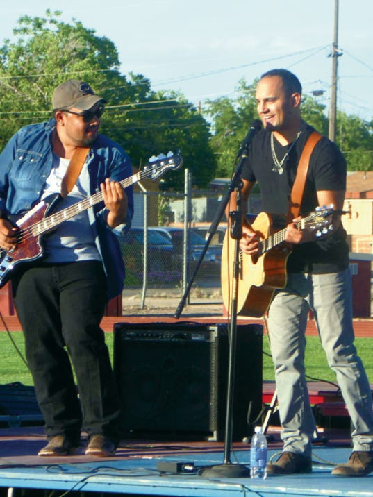 Courtesy Photo   Chris Nunez,. left, and Frank Gomez are one-half of Border Avenue. The quartet played an outdoor concert at DHS Memorial Stadium to raise money for the Bataan Elementary School's donation to the Cancer Support Group of Deming and Luna County Inc. during its Celebration of Life event.