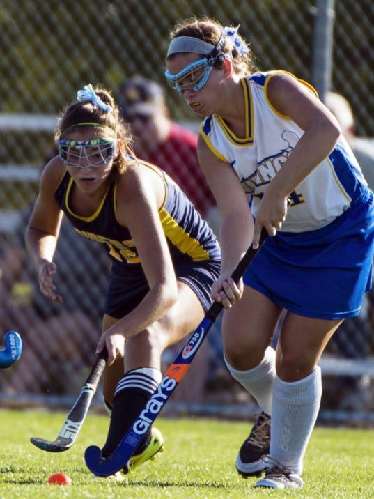 Elco's Katie Fields battles Northern Lebanon's Cassidy Ritchie for possession of the ball. Elco defeated Northern Lebanon 6-2 at Northern Lebanon on Tuesday behind four goals from Fields, who tied a single-game school record with the scoring binge.