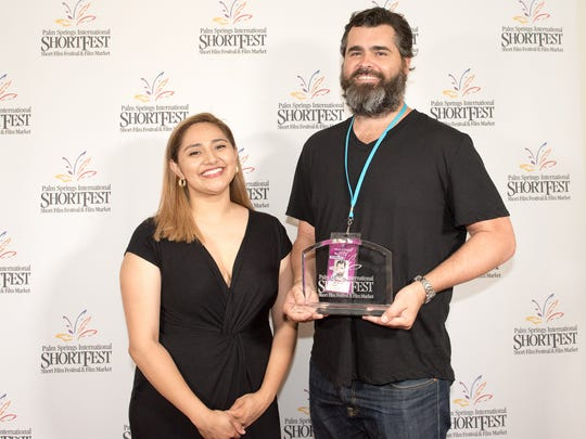 """ShortFest Director Lili Rodriguez presents Australian director Sean Meehan with his award for winning the ShortFest Online Film Festival for his Australian/Canadian production of """"Lost Face."""""""