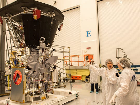 Last year, the Parker Solar Probe recently had its heat shield (top) attached in a clean room at Johns Hopkins' Applied Physics Laboratory in Laurel, Md.