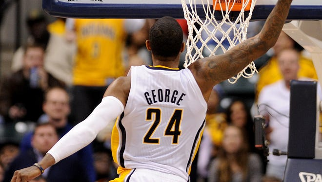 Indiana Pacers forward Paul George does a 360 dunk against the Los Angles Clippers inside Bankers Life Fieldhouse, Saturday, January 18, 2014, in Indianapolis.