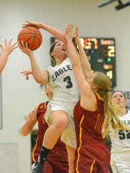 Olivet's Teona Feldpausch drives the basket Tuesday
