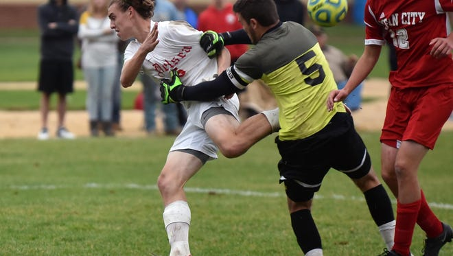 Delsea Doug Gant's shot is stopped by Ocean City's Russell Lindsay in Wednesday's South Jersey Group 3 Final. The Red Raiders prevailed 2-1 in overtime.