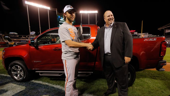 Chevy executive Rikk Wilde presents Giants pitcher and World Series MVP Madison Bumgarner with a Chevrolet Colorado pickup.