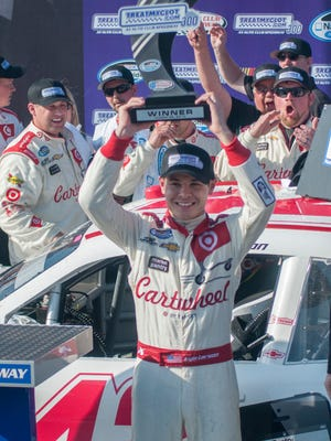 Kyle Larson celebrates after winning the Xfinity Series race at Auto Club Speedway in March of 2014.