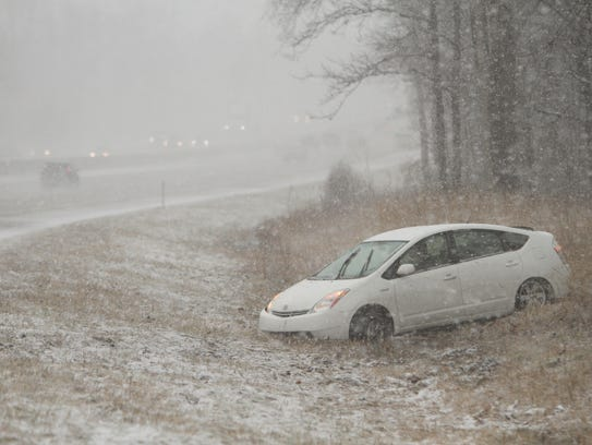 A Toyota Prius heading westbound on I-96 east of the
