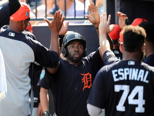 Tigers outfielder Christin Stewart is congratulated after scoring against the Yankees during the sixth inning of a spring training game Feb. 28, 2018 in Tampa, Fla.