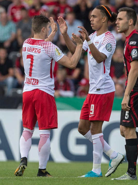 FILE - In this Aug 13, 2017 file photo, Leipzig's Marcel Sabitzer celebrates with teammate Yussuf Poulsen, right, after giving his side a 1-0 lead during the GermanSoccer  Cup first-round match between Sportfreunde Dorfmerkingen and RB Leipzig in the Ostalb Arena in Aalen, Germany. RB Leipzig will play  FC Schalke 04  in Gelsenkirchen, Germany,  in the first match of the new Bundesliga soccer season on Saturday Aug. 19, 2017. (Daniel Maurer/dpa via AP,file)