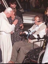 Pope John Paul II blesses  Steven McDonald as he leaves
