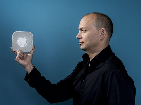 Tony Fadell holds his Nest Protect, a smoke and carbon monoxide detector.