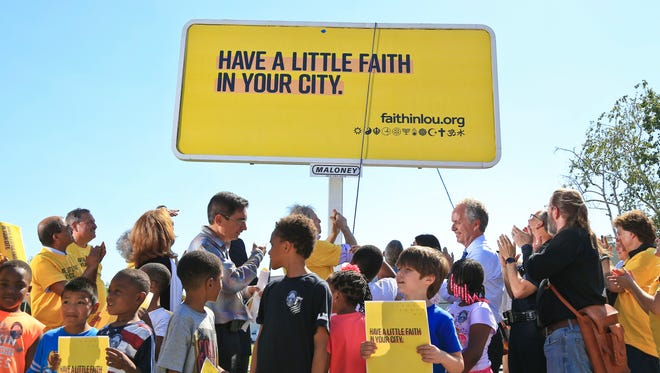 The tenth billboard in the Interfaith community campaign was unveiled on the corner of East Breckenridge and Preston Streets Friday afternoon and was attended by Louisville Mayor Greg Fischer, LMPD Chief Steve Conrad as well as local religious leaders.