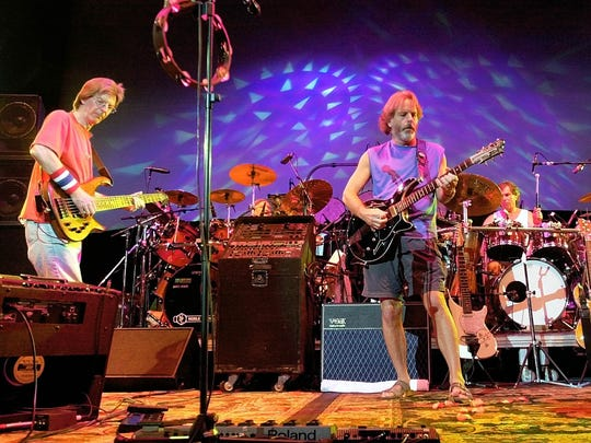 Phil Lesh (from left), Bill Kreutzmann, Bob Weir and Mickey Hart perform during a 2002 reunion concert in East Troy, Wis.