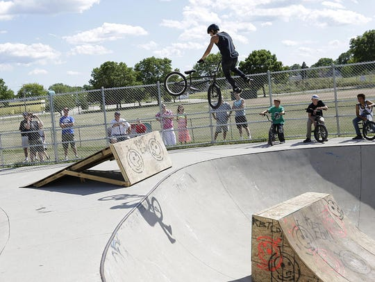 Dallas Weimer of Fond du Lac, spins his bike 360 degrees,