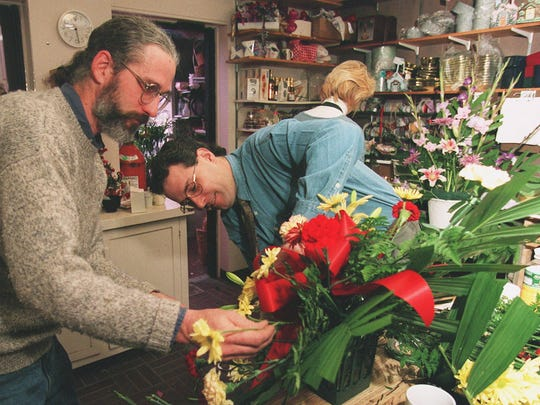 In November 1995, brothers Steven and Keith Rockcastle work on a standing spray of flowers at Rockcastle Florist in Greece. The men were preparing to leave for the White House to help decorate it for the holidays.