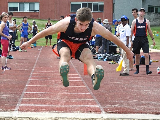 Briarcliff's Dmitry Cafri stretches to land his triple jump. He jumped 42-11 for the Class B win..