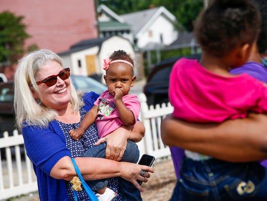 IndyStar reporter Maureen Gilmer holds Olivia, 1, daughter