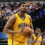 Mar 11, 2014; Indianapolis, IN, USA; Indiana Pacers center Andrew Bynum (17) shoots a free throw against the Boston Celtics at Bankers Life Fieldhouse. Indiana defeats Boston 94-83. Mandatory Credit: Brian Spurlock-USA TODAY Sports ORG XMIT: USATSI-141376 ORIG FILE ID:  20140311_mje_ss1_248.jpg