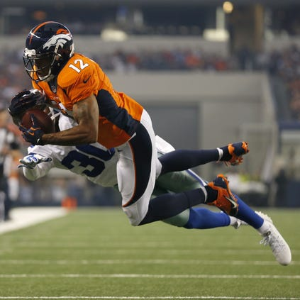 Aug 28, 2014; Arlington, TX, USA; Denver Broncos receiver Andre Caldwell (12) catches a pass in the first quarter against the Dallas Cowboys at AT&T Stadium. Mandatory Credit: Matthew Emmons-USA TODAY Sports