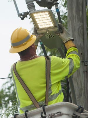 Sean Smith with Atlantic City Electric installs an LED street light on Kali Rd. in Winslow Twp. It was the first of 900 LED street lights slated for municipal roads in 6 towns. Tuesday, June 16, 2015.