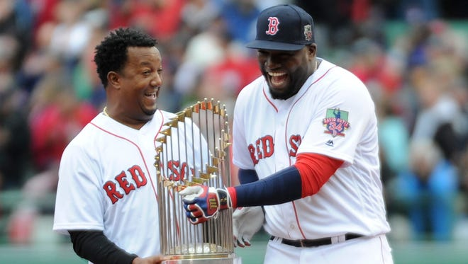 David Ortiz and Pedro Martinez commemorate the Red Sox's 2004 championship during ceremonies Sunday.