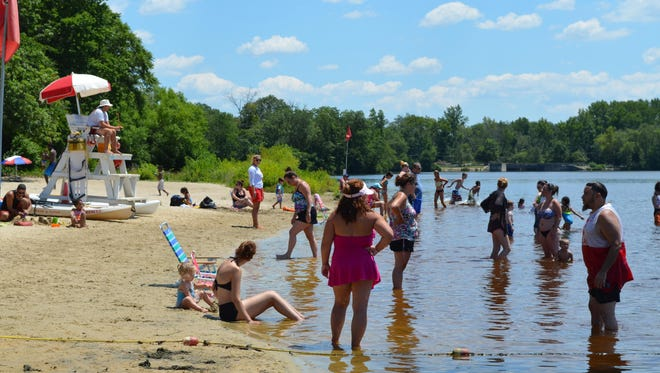 The beach at Parvin State Park was busy Saturday during the inaugural Christmas in July celebration. Visitors enjoyed the beach as well as special activities, such as vendor booths, face painting, train rides and an inflatable water slide.