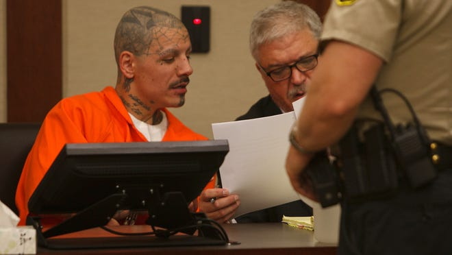 Mario Antoine Lucero looks over evidence with his attorney Edward Flint during an evidentiary hearing on charges Lucero murdered his sister's common-law husband in this Sept. 18, 2014 file photo in St. George's 5th District Court. Lucero pleaded guilty Monday to slaying his cellmate earlier this year at the Draper prison where he is now being housed.