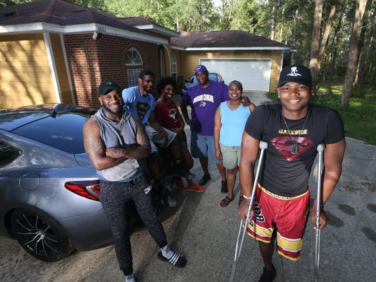 Cam Brown stands with his family at their home in Tallahassee. Family members are parents Sam and Michelle, their godson Rod Washington, brother Bin, and sister Maya.